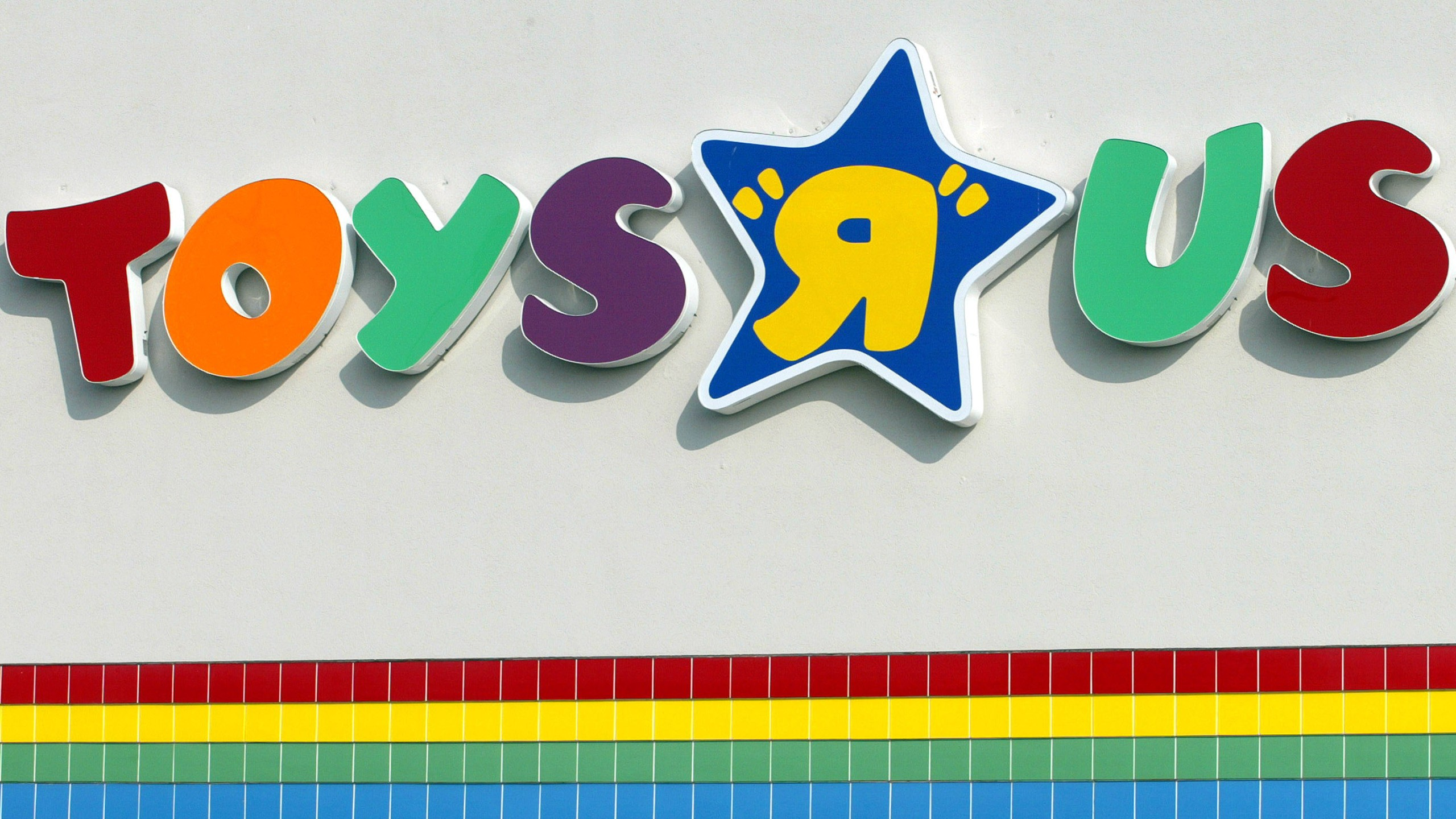 "A Toys ""R"" Us sign is visible at one of its stores January 28, 2002 in Arlington Heights, Illinois. (Credit: Tim Boyle/Getty Images)"