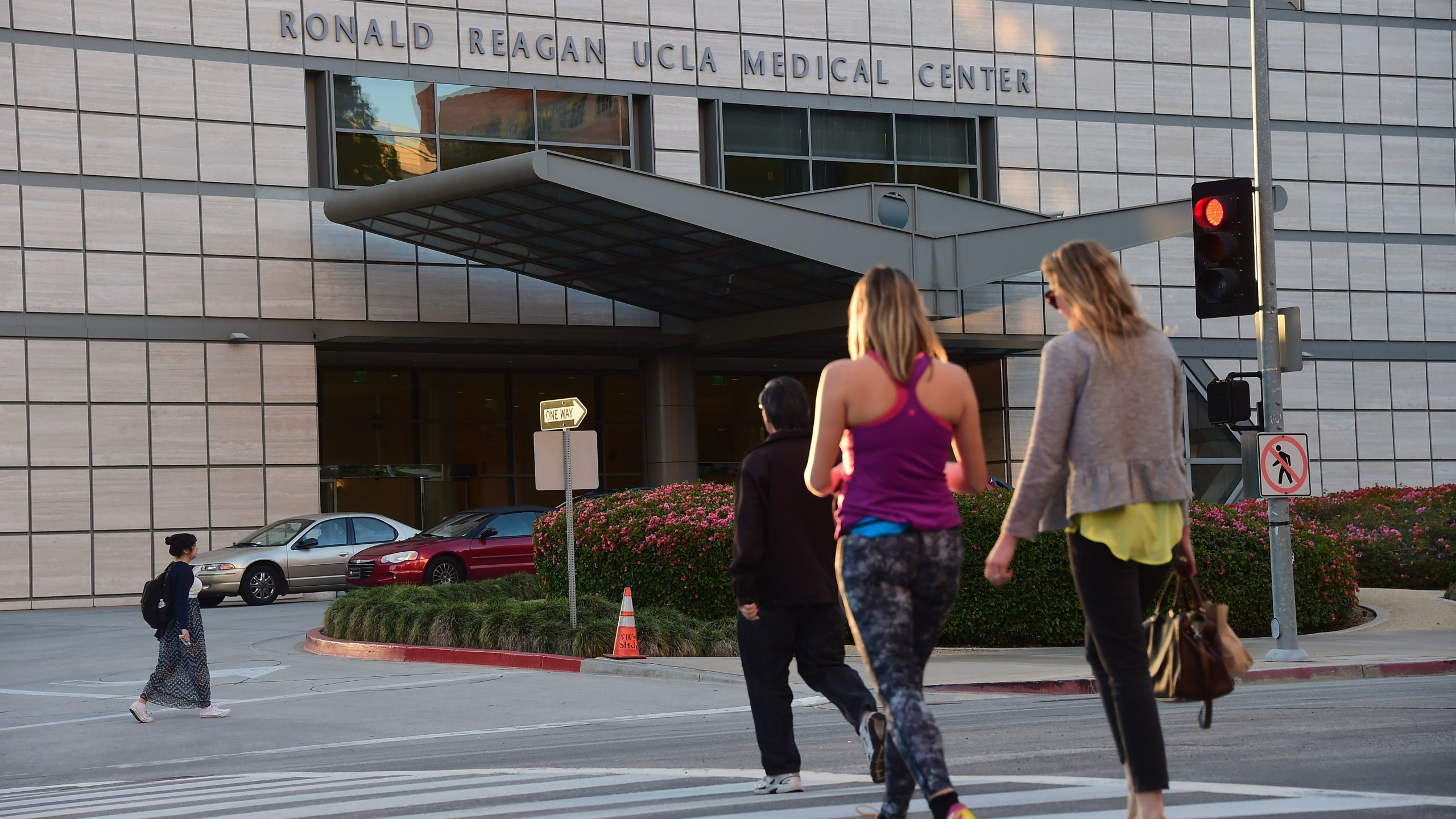 Pedestrians cross the road to the Ronald Reagan UCLA Medical Center on March 5, 2015. (Credit: Frederic J. Brown / AFP / Getty Images)