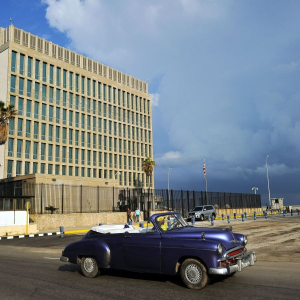 An old American car passes by the U.S. Embassy in Havana on Dec. 17, 2015. (Credit: Yamil Lage / AFP / Getty Images)