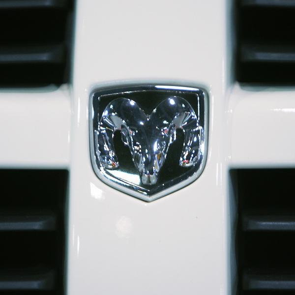The logo for Dodge Ram can be seen on the grill of a truck. (Credit: ROBERTO SCHMIDT/AFP/Getty Images)