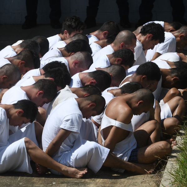 Handcuffed inmates, members of MS-13 and Barrio 18 gangs, are made to wait upon arrival at the maximum security prison in Zacatecoluca, 65 km east of San Salvador, El Salvador, on Aug. 30, 2017. (Credit: MARVIN RECINOS/AFP/Getty Images)