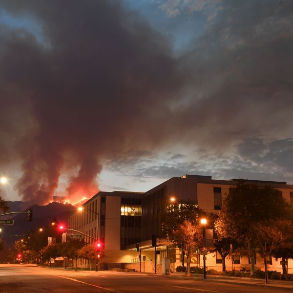 The La Tuna fire burns above downtown Burbank on Sept. 3, 2017. (Credit: Robyn Beck / AFP / Getty Images)