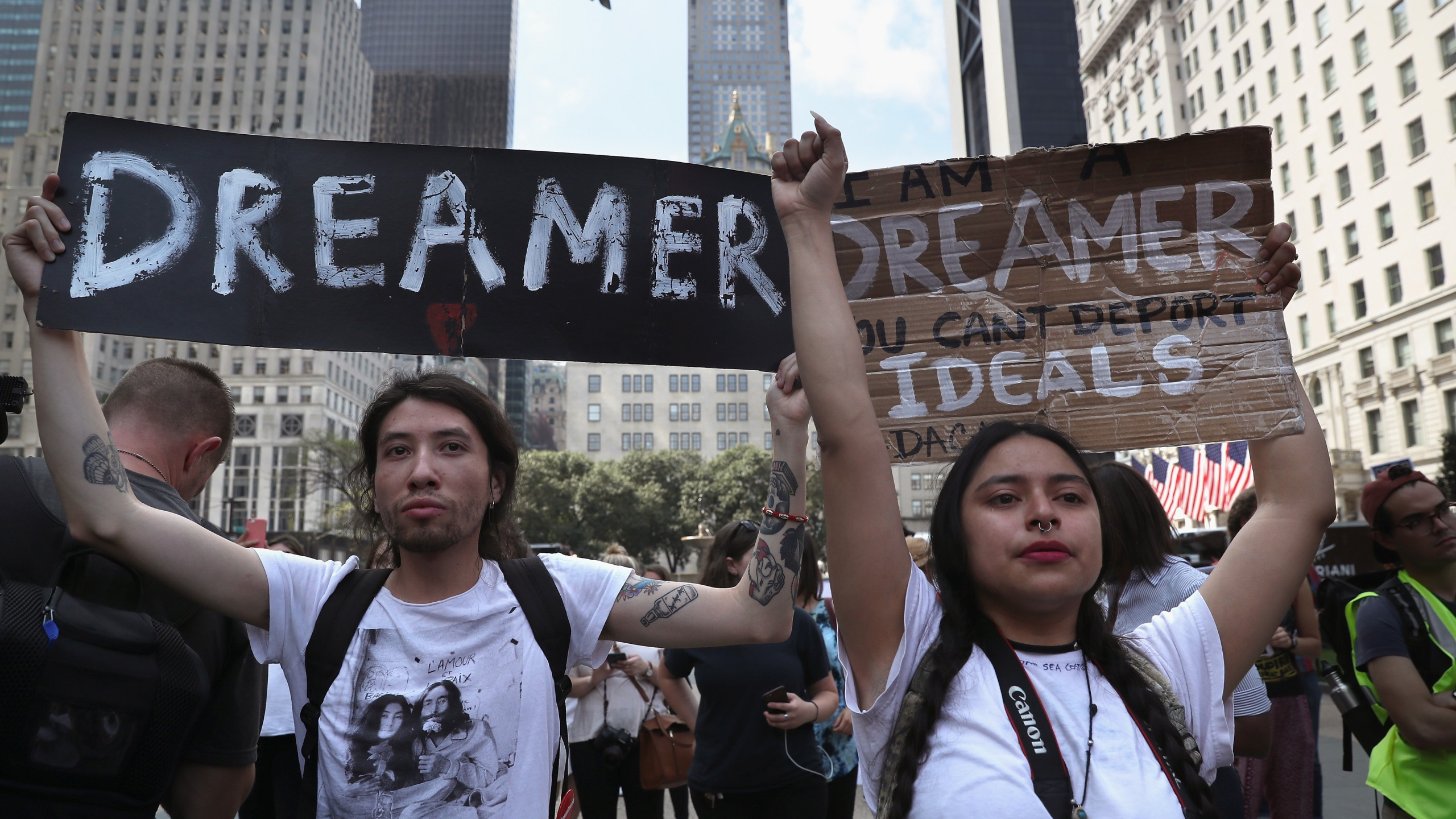 Jovan Rodrigo, 27, and Gloria Mendoza, 26, take part in a protest near Trump Tower on Sept. 5, 2017, in New York City. (Credit: John Moore / Getty Images)
