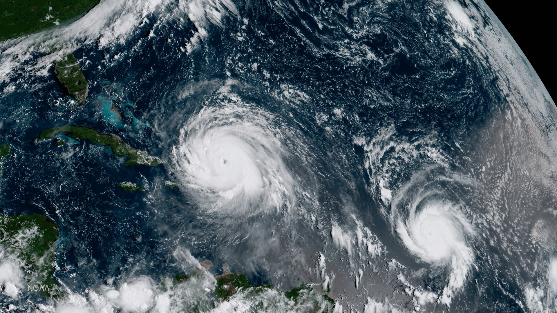 In this NOAA handout image, NOAA's GOES satellite shows Hurricane Irma, left, and Hurricane Jose on Sept. 7, 2017, in the Atlantic Ocean. (Credit: NOAA GOES Project via Getty Images)