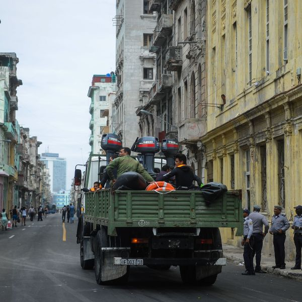 A truck with divers drives along a street of Havana, on Sept. 9, 2017. (Credit: Yamil Lage/AFP/Getty Images)
