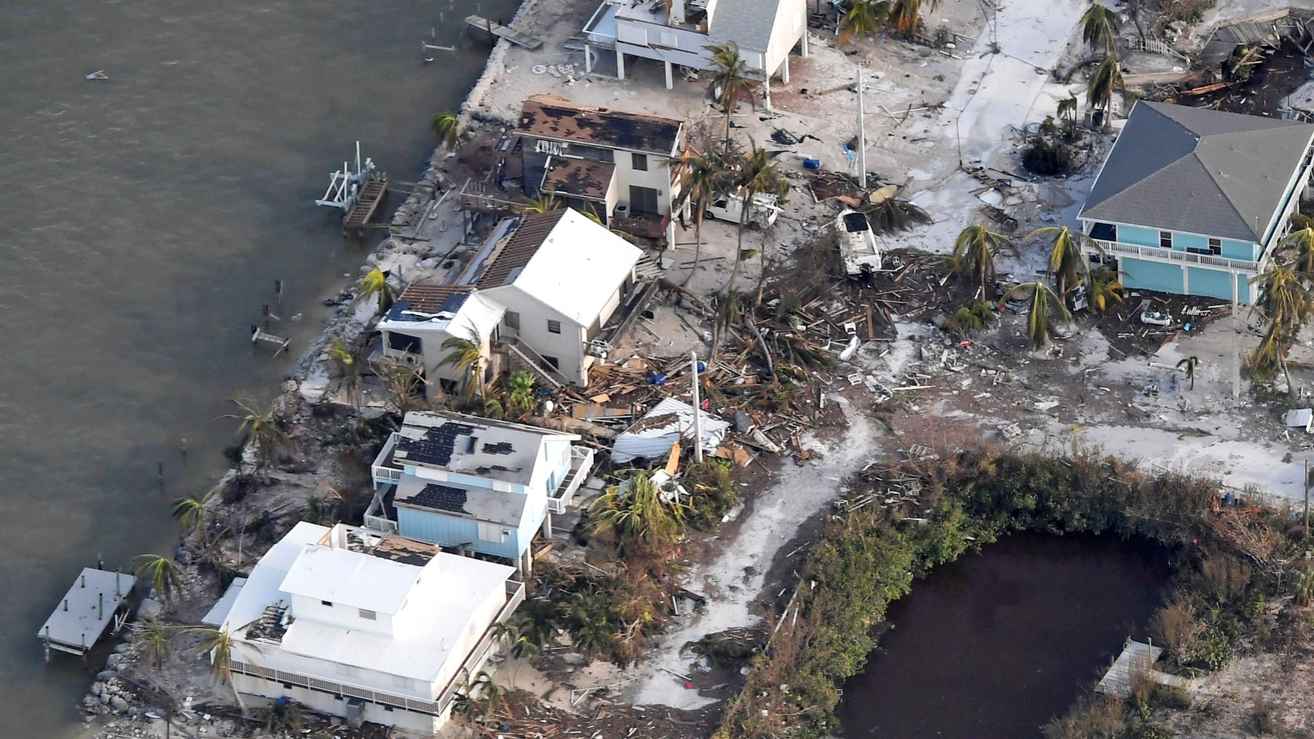 Damaged houses are seen in the aftermath of Hurricane Irma on September 11, 2017 over the Florida Keys, Florida (Credit: Matt McClain -Pool/Getty Images)