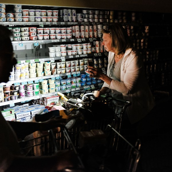 People shop in a supermarket, one of the few open, with limited electricity three days after Hurricane Irma swept through the area on September 13, 2017 in Naples, Florida. (Credit: Spencer Platt/Getty Images)