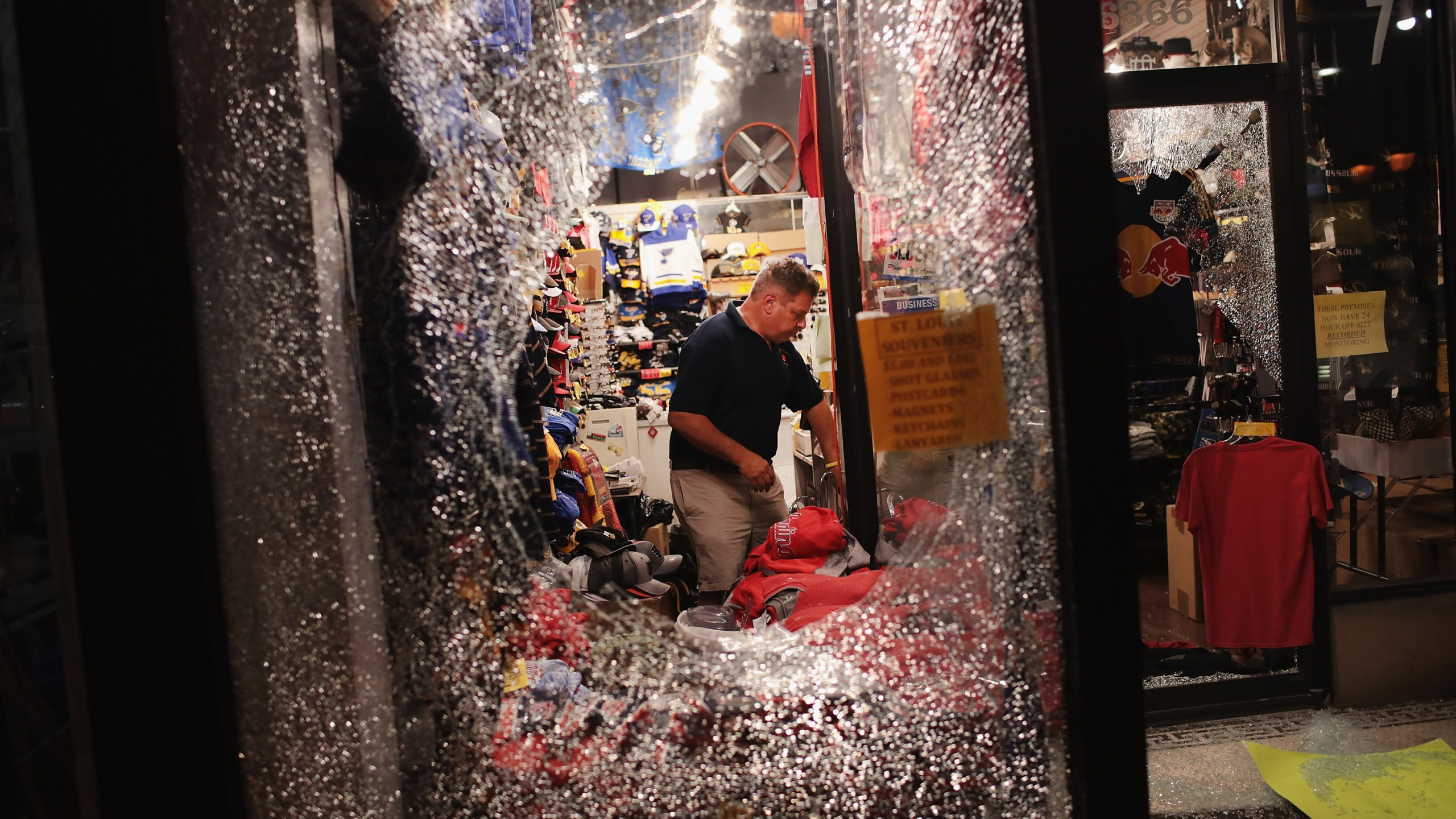 A worker cleans up broken glass from a window smashed during a protest of the acquittal of former St. Louis police officer Jason Stockley on Sept. 16, 2017, in St. Louis, Missouri. (Credit: Scott Olson / Getty Images)