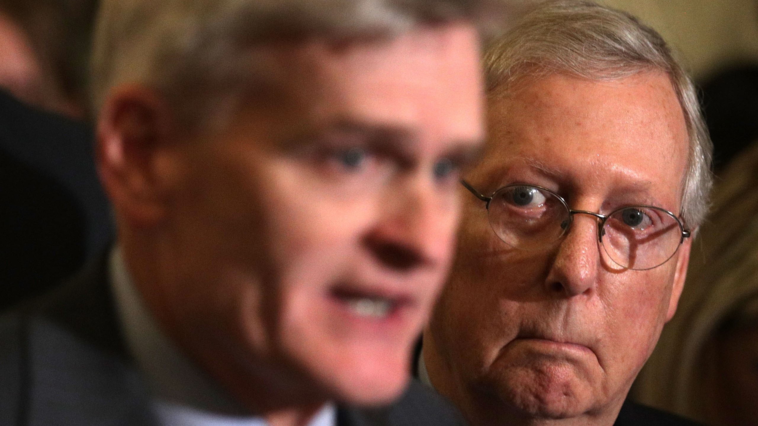 Sen. Bill Cassidy, left, speaks as Senate Majority Leader Sen. Mitch McConnell listens during a news briefing after the weekly Senate Republican policy luncheon at the Capitol Sept. 19, 2017. (Credit: Alex Wong/Getty Images)