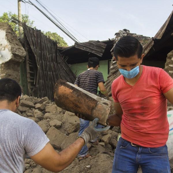 Volunteers clean the debris from damaged houses in Jojutla de Juarez on Sept. 20, 2017, a day after a strong quake hit central Mexico. (Credit: ENRIQUE CASTRO SANCHEZ/AFP/Getty Images)