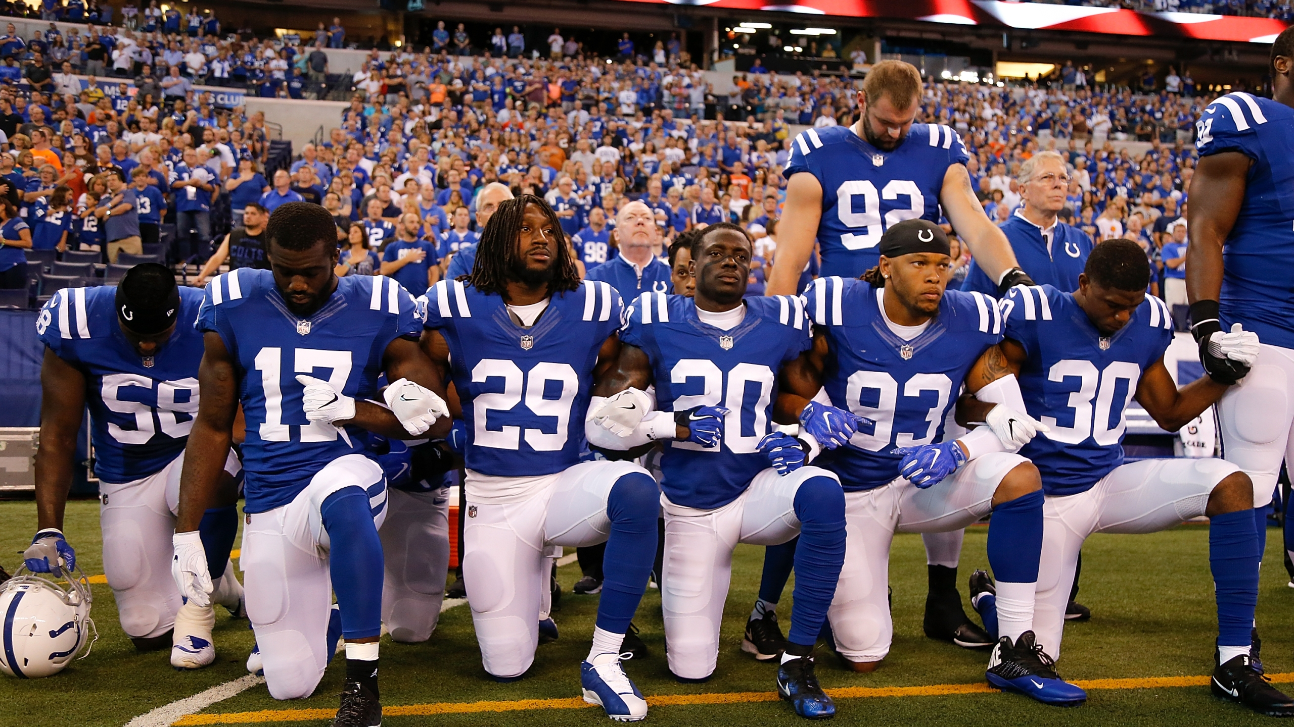 Members of the Indianapolis Colts stand and kneel for the national anthem prior to the start of the game between the Indianapolis Colts and the Cleveland Browns at Lucas Oil Stadium on Sept. 24, 2017. (Credit: Michael Reaves / Getty Images)