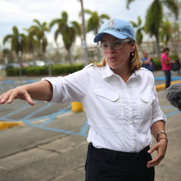 San Juan Mayor Carmen Yulin Cruz speaks to the media as she arrives at the temporary government center setup at the Roberto Clemente stadium in the aftermath of Hurricane Maria on September 30, 2017. (Credit: Joe Raedle/Getty Images)