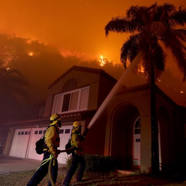Firefighters battle the Canyon fire as flames threaten a neighborhood in Corona on Sept .25, 2017. (Credit: Luis Sinco)