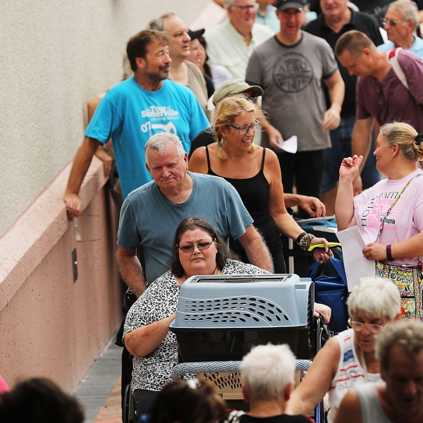 People arrive at a shelter at Alico Arena in Fort Myers, Florida where thousands are hoping to ride out Hurricane Irma, on Sept. 9, 2017. (Credit: Spencer Platt/Getty Images)