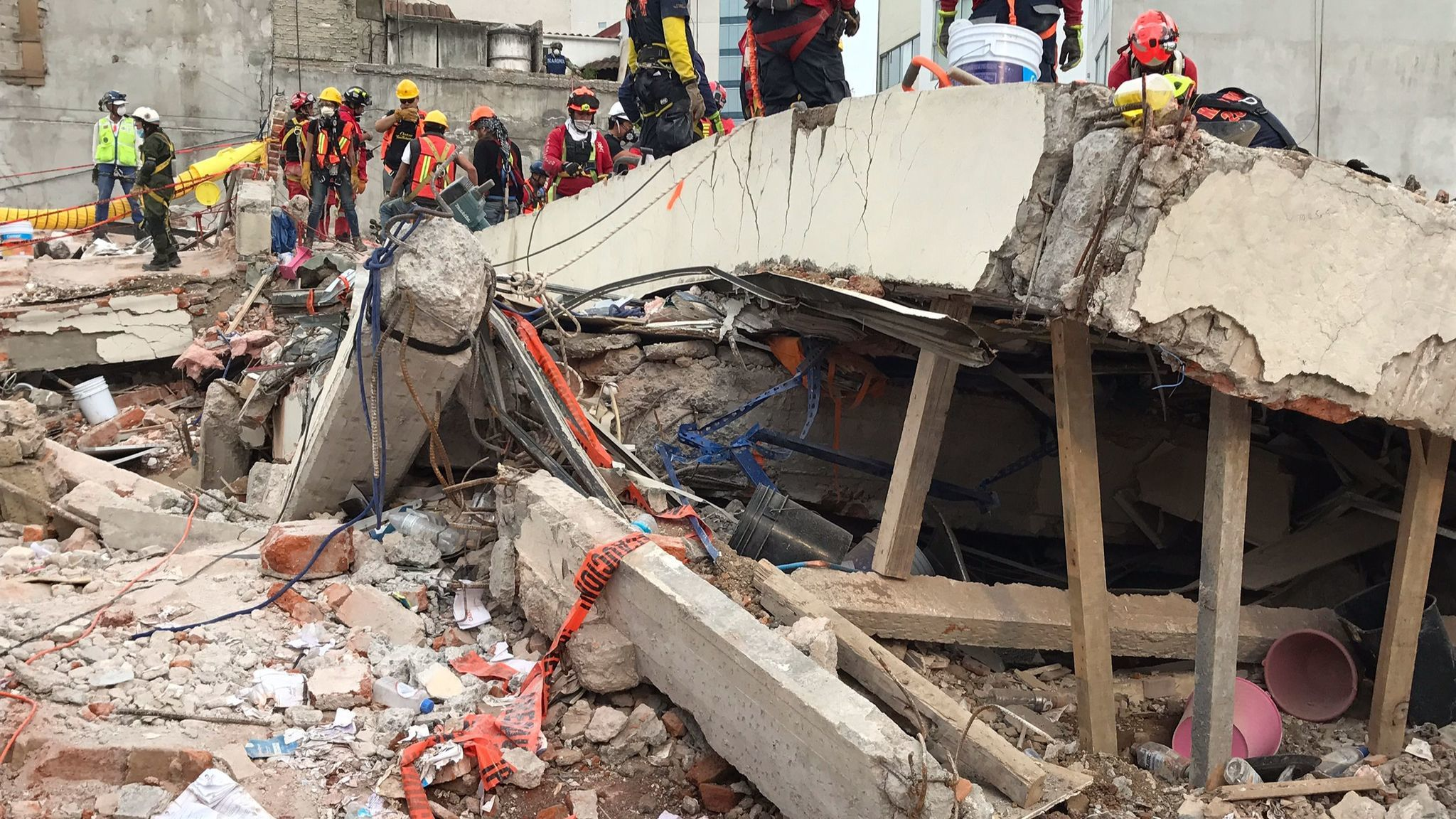 A Mexico City office building collapsed in the Sept. 19, 2017, earthquake, leaving entire floors stacked like pancakes. (Credit: Rong-Gong Lin II / Los Angeles Times)