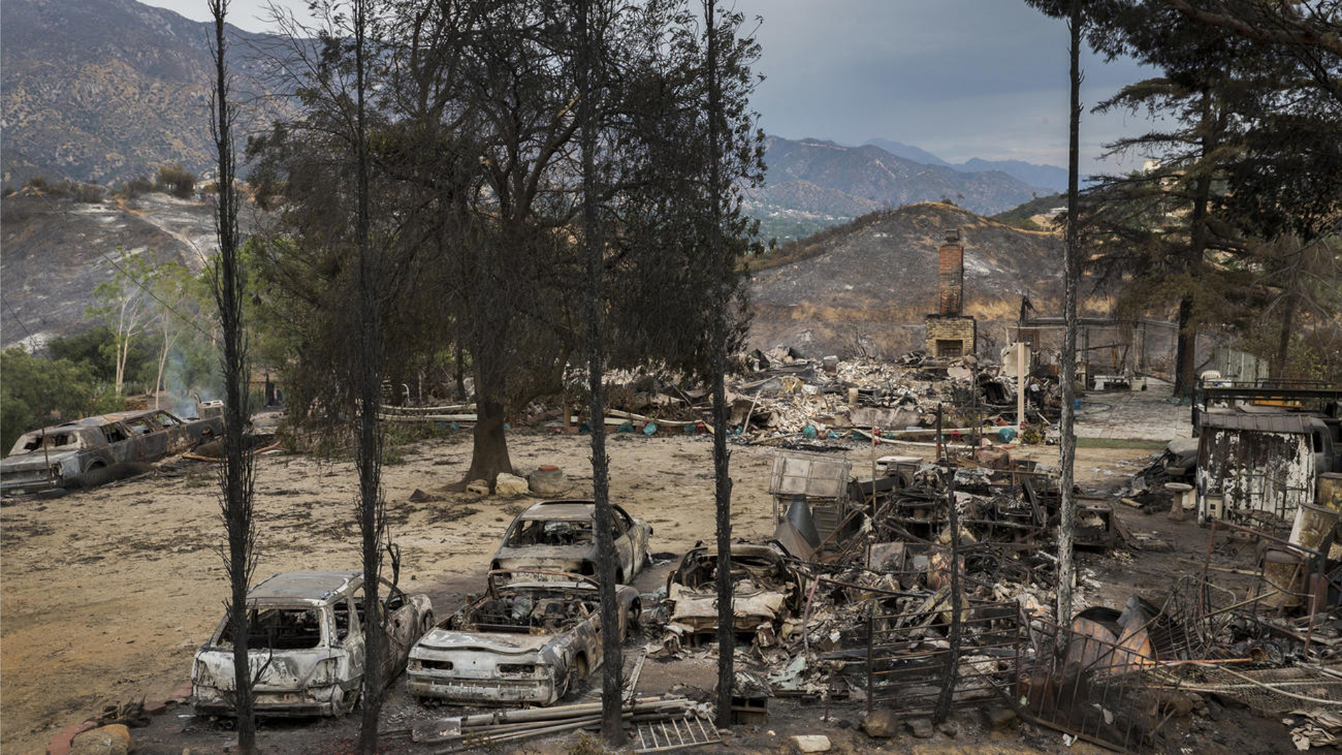 A home, cars and property lies in ruins as it was one of three homes and a shed were destroyed in the La Tuna Canyon fire. (Credit: Allen J. Schaben / Los Angeles Times)