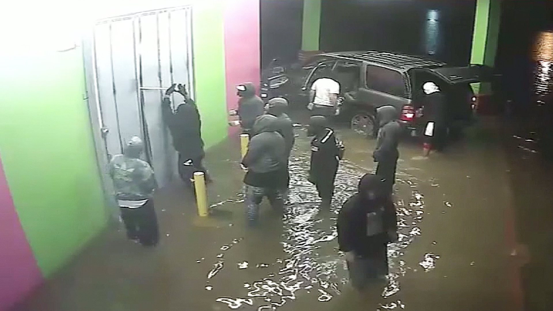 A group of looters can be seen outside a Houston store during Hurricane Harvey. (Credit: Houston Police Department)