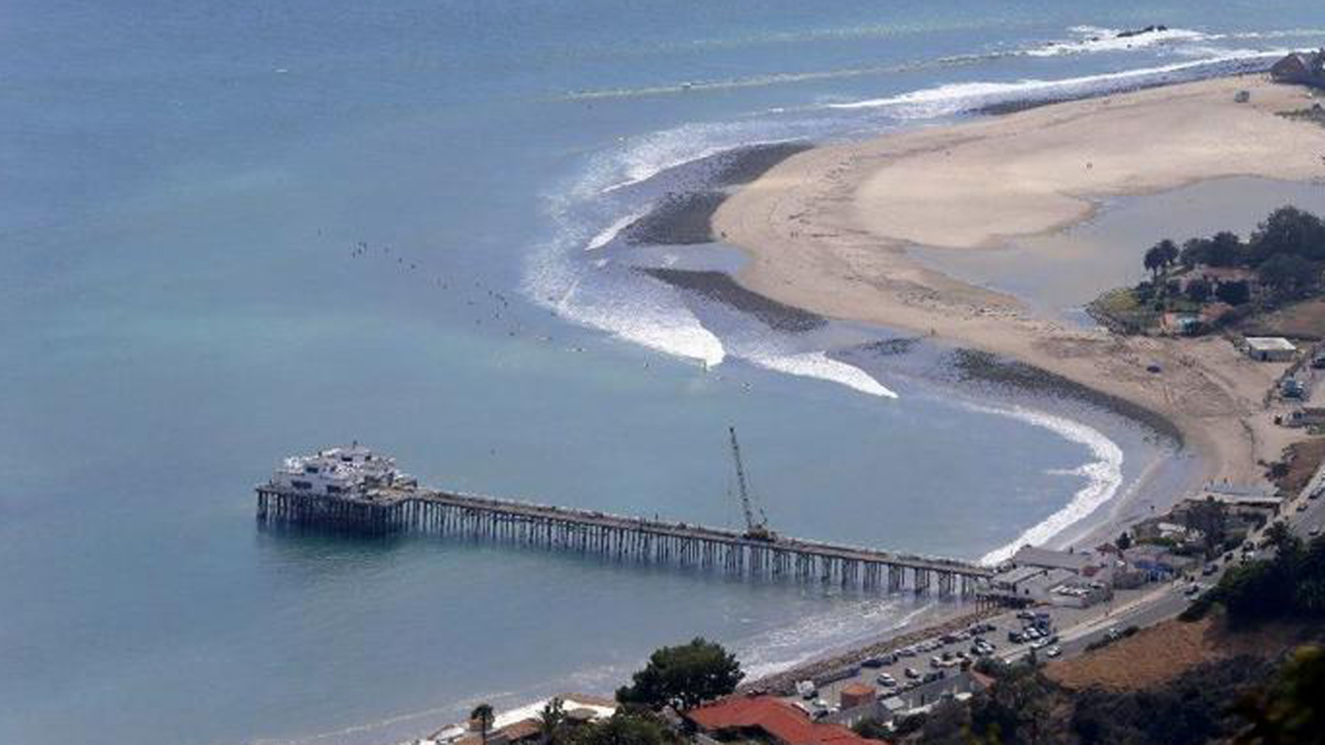 Pictured is the Malibu Pier, which is about a mile from the site where a man was found Saturday after plunging from a private chopper into the ocean. (Credit: Allen J. Schaben / Los Angeles Times)