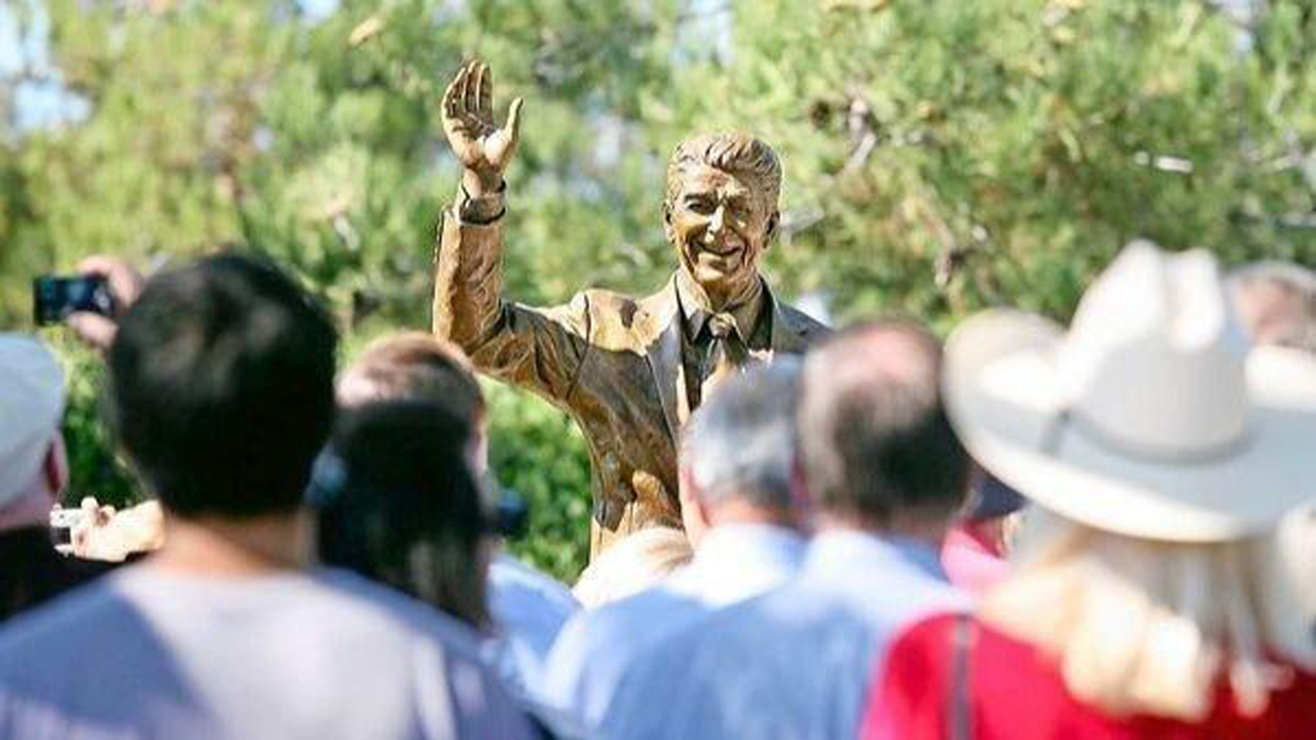 The Ronald Reagan statue at Bonita Canyon Sports Park in Newport Beach is pictured at its dedication in 2011. It will get a new home this year among the sculptures at Civic Center Park in Newport Beach. (Credit: Los Angeles Times)