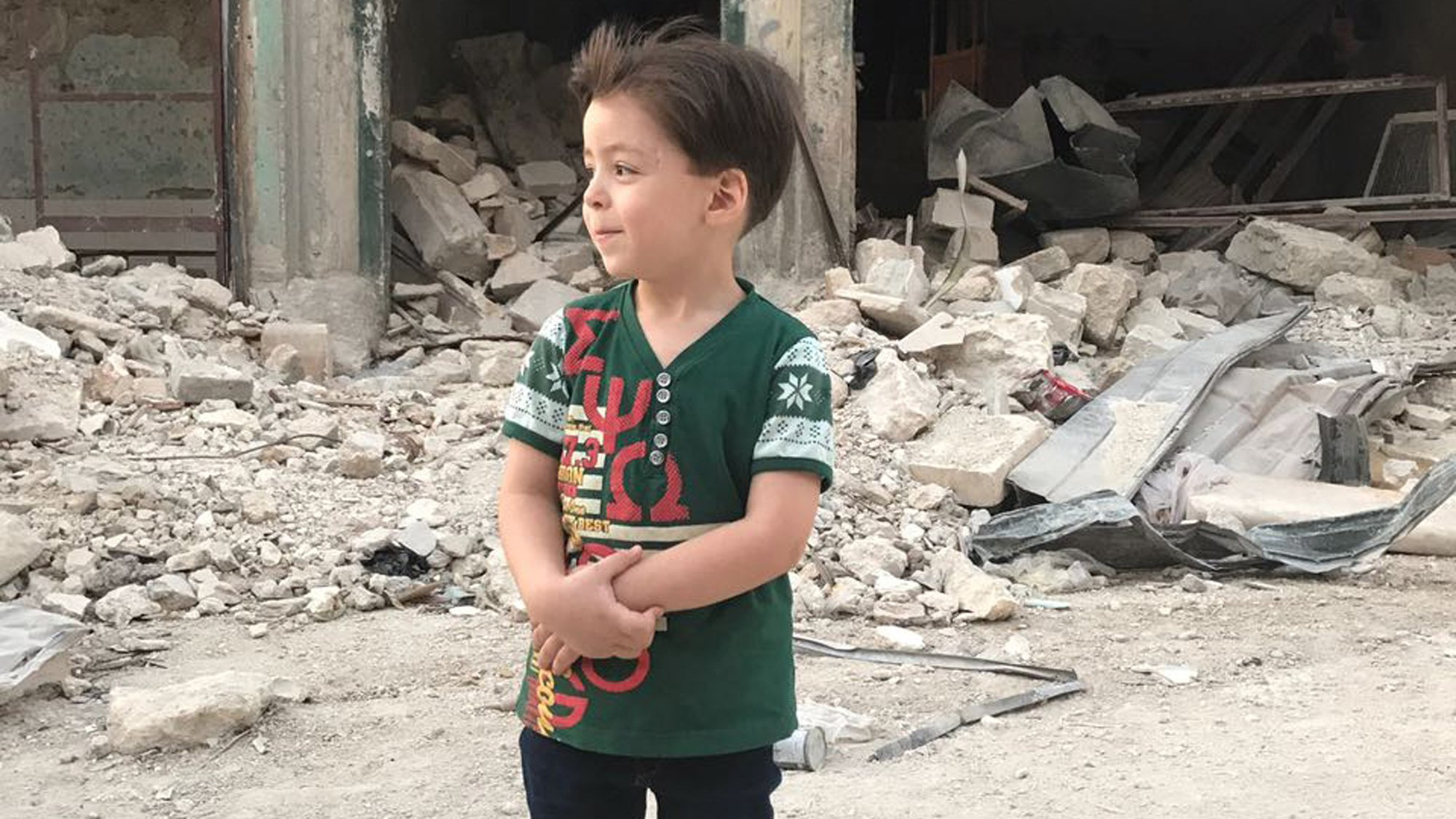 Omran Daqneesh is seen in Aleppo a year after his home partly collapsed in a strike. (Credit: CNN)