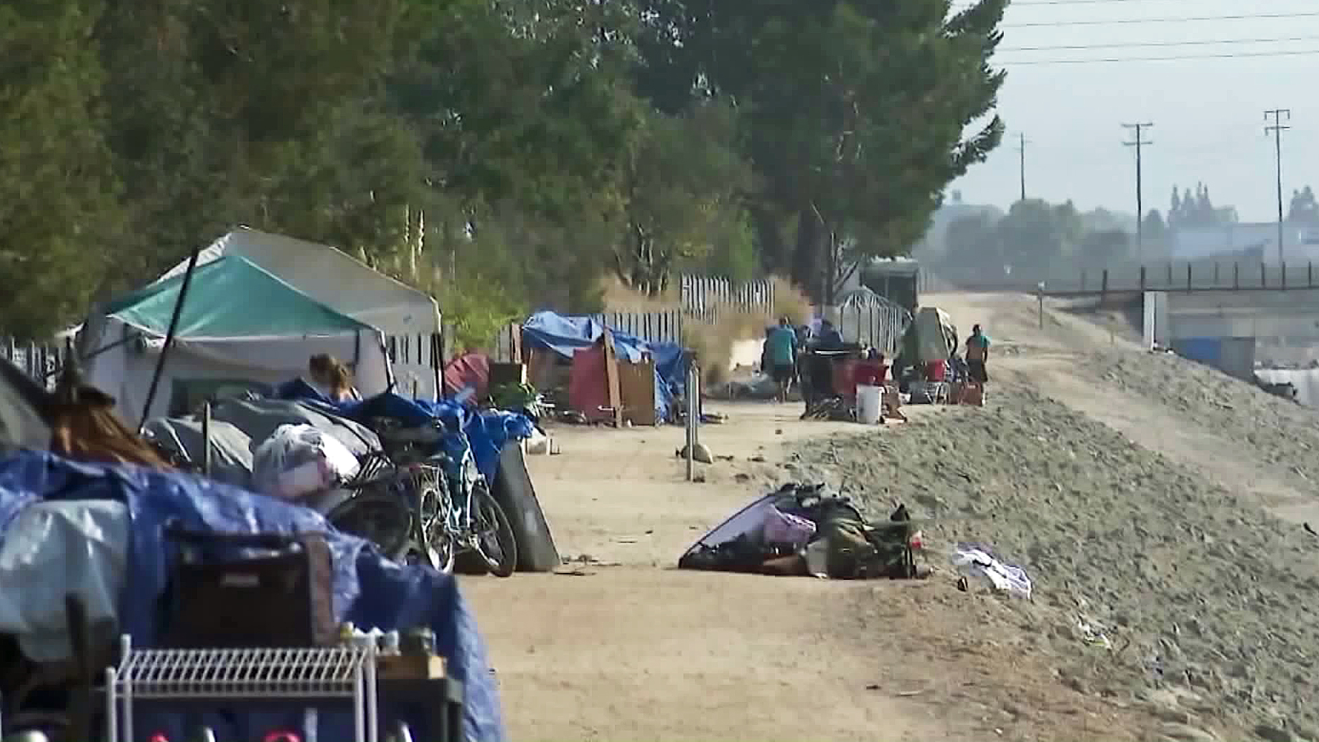 A homeless encampment along the Santa Ana River is seen on Sept. 12, 2017. (Credit: KTLA)