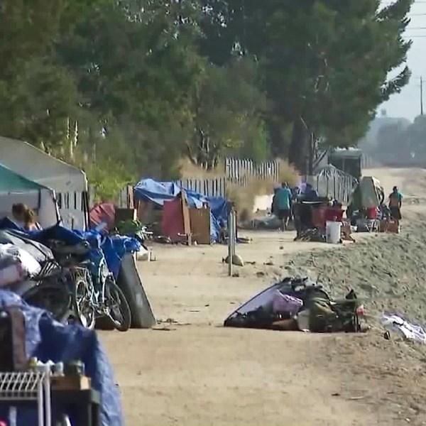 A homeless encampment along the Santa Ana River is seen on Sept. 12, 2017. (Credit: KTLA)