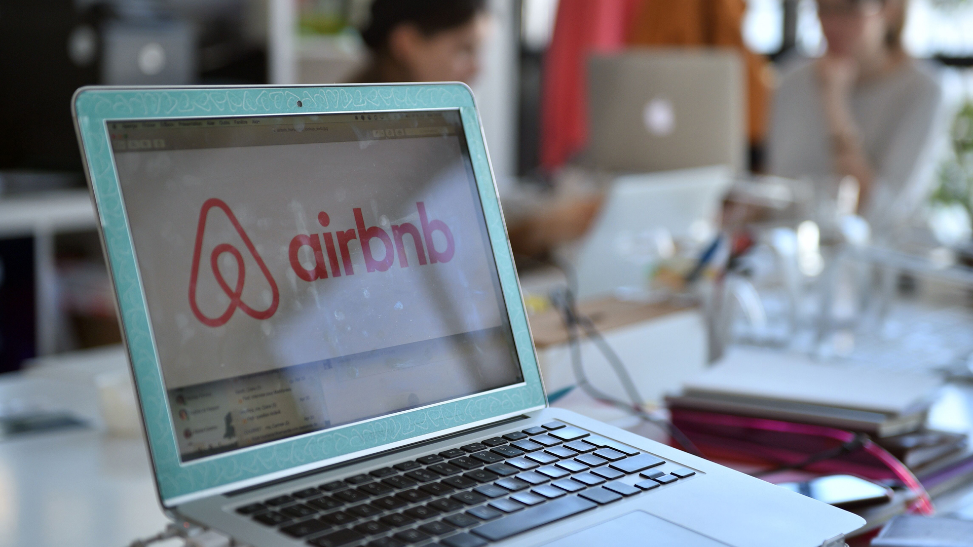 A screen showing the logo for lodging service Airbnb is seen on a computer screen in the company's offices in Paris on April 21, 2015.(Credit: Martin Bureau/AFP/Getty Images)