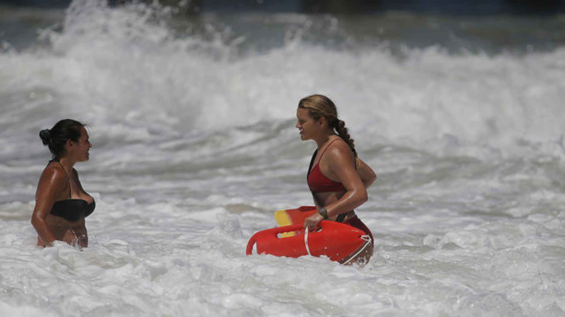 A 53-year-old man was reported missing about 4 p.m. off Huntington Beach. Above, a lifeguard warns a swimmer about rip currents in July. (Allen J. Schaben / Los Angeles Times)