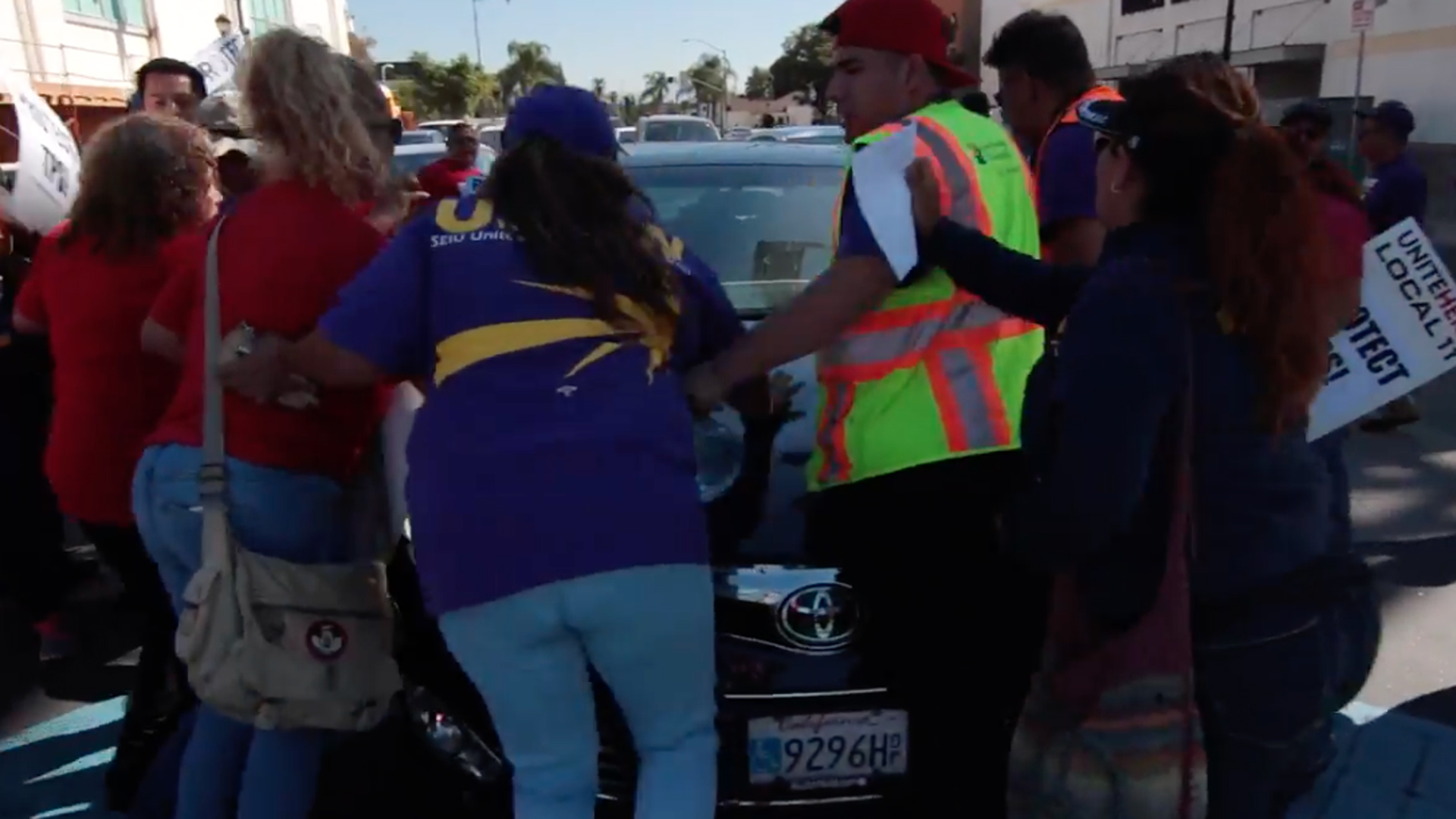 A still image from a video shows a car attempting to drive through a group of protesters in Brea on Oct. 26, 2017. (Credit: Antonio Mendoza / UNITE HERE Local 11)