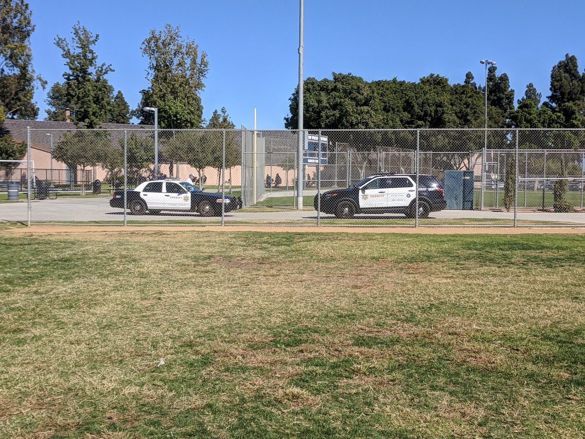 A photo shared on Twitter shows Los Angeles County Sheriff's Department vehicles respond to an alleged child molestation incident at Smith Park in Pico Rivera on Oct. 22, 2017.