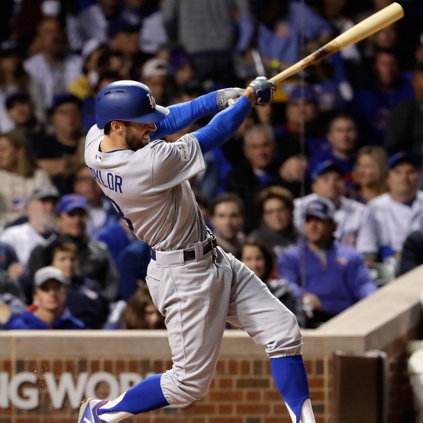 Chris Taylor of the Los Angeles Dodgers hits a triple in the fifth inning against the Chicago Cubs during game three of the National League Championship Series at Wrigley Field on October 17, 2017 in Chicago. (Credit: Jamie Squire/Getty Images)