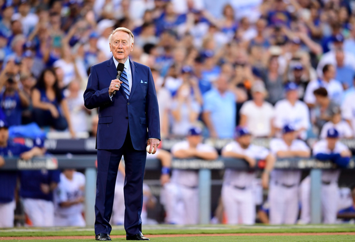 Vin Scully speaks to fans before game two of the 2017 World Series between the Houston Astros and the Los Angeles Dodgers at Dodger Stadium on October 25, 2017 in Los Angeles. (Credit: Harry How/Getty Images)