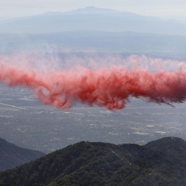 A plane drops fire retardant near the Mount Wilson Observatory on Oct. 17, 2017. (Credit: Irfan Khan / Los Angeles Times)