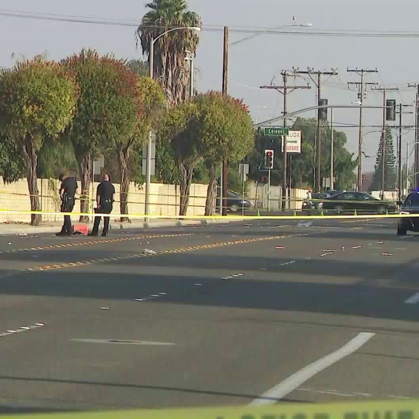 Police inspect a truck that was driven by a man who was shot by officers in Westminster on Oct. 14, 2017. (Credit: KTLA)