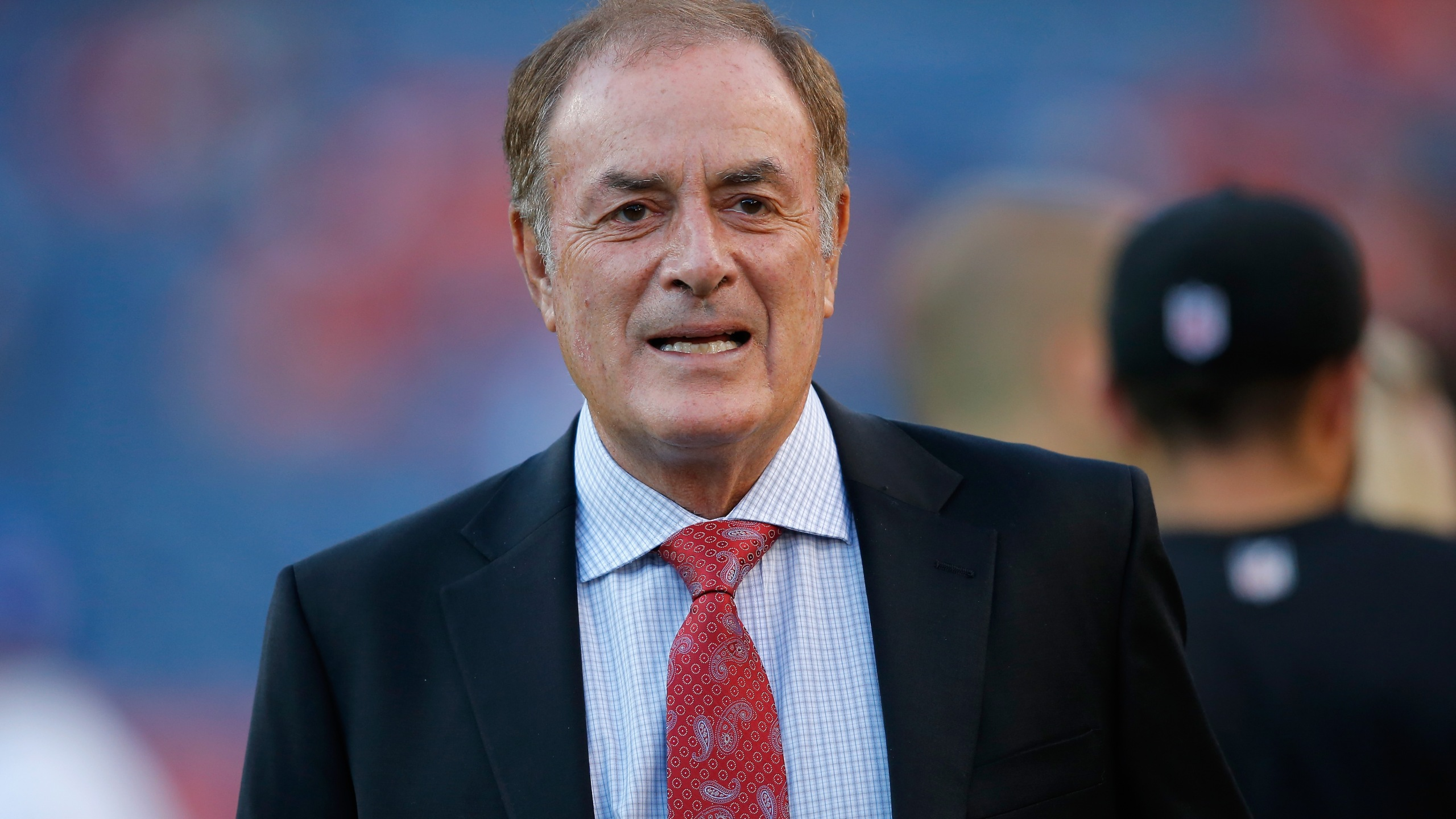 Al Michaels of NBC Sports works the game between the San Francisco 49ers and the Denver Broncos at Sports Authority Field at Mile High on October 19, 2014 in Denver, Colorado. (Credit: Doug Pensinger/Getty Images)