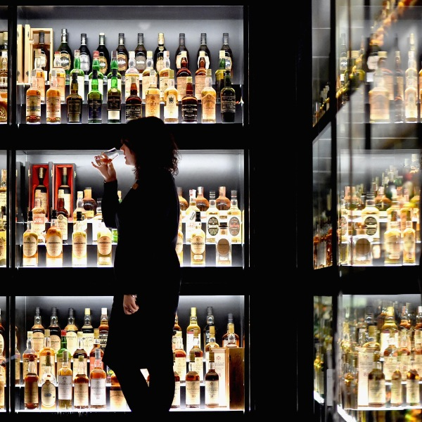 Members of the public examine whisky samples inside the Diageo Claive Vidiz Collection, the world's largest collection of Scottish whisky on display at The Scotch Whisky Experience on Sept. 3, 2015 in Edinburgh. (Credit: Jeff Mitchell / Getty Images)