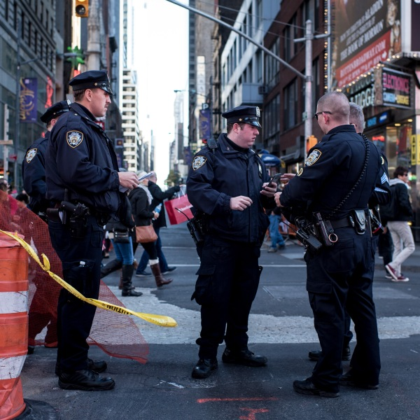 Police officers keep watch in Times Square following a series of terrorist attacks in Paris on Nov. 14, 2015, in New York City. (Credit: Andrew Renneisen / Getty Images)