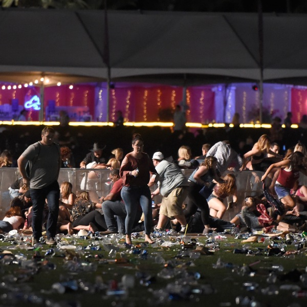 People run from the Route 91 Harvest country music festival after apparent gunfire was heard on Oct. 1, 2017, in Las Vegas. (Credit: David Becker/Getty Images)