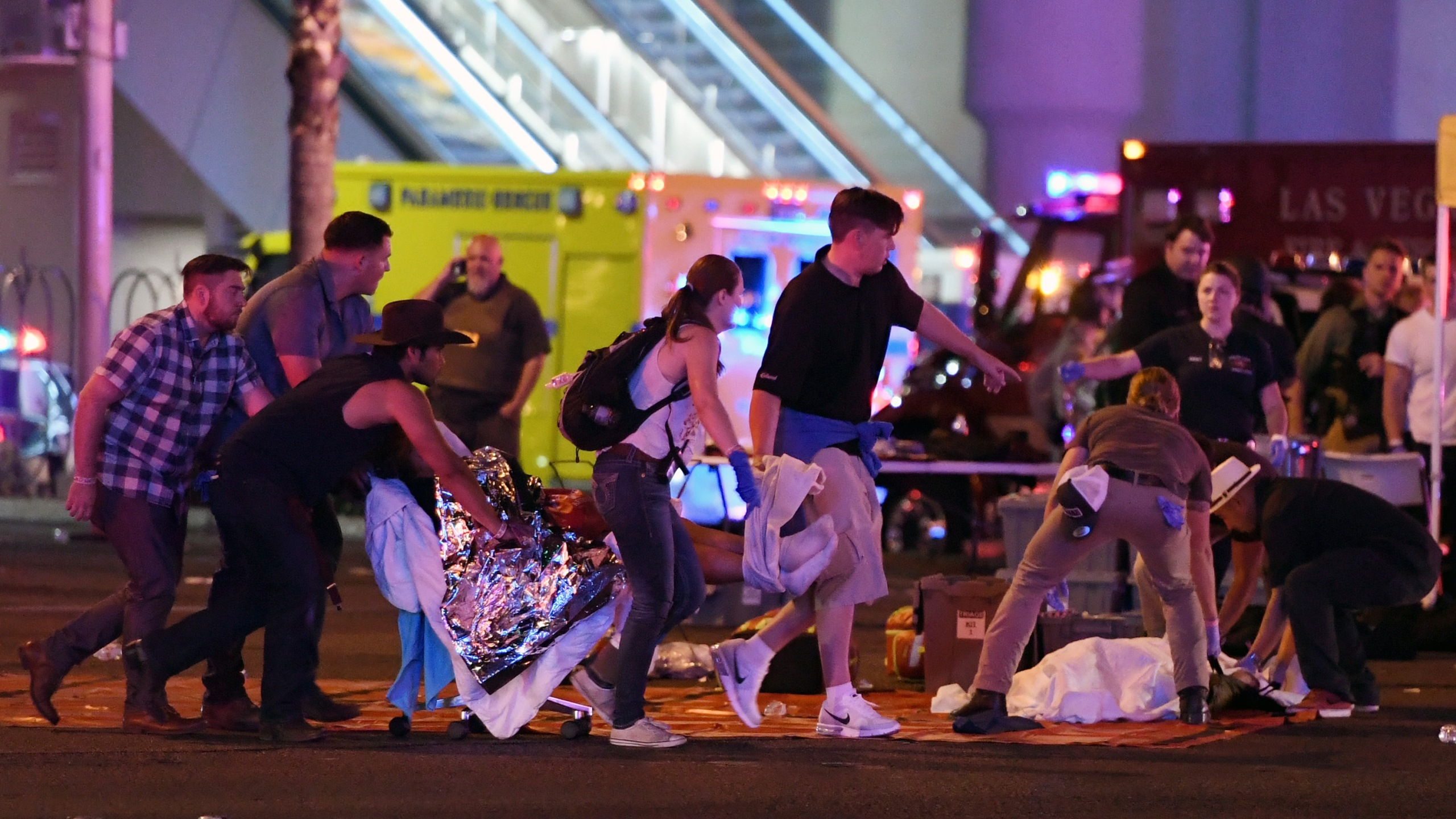 An injured person is tended to in the intersection of Tropicana Ave. and Las Vegas Boulevard after a mass shooting at a country music festival nearby on Oct. 2, 2017 in Las Vegas, Nevada. (Credit: Ethan Miller/Getty Images)