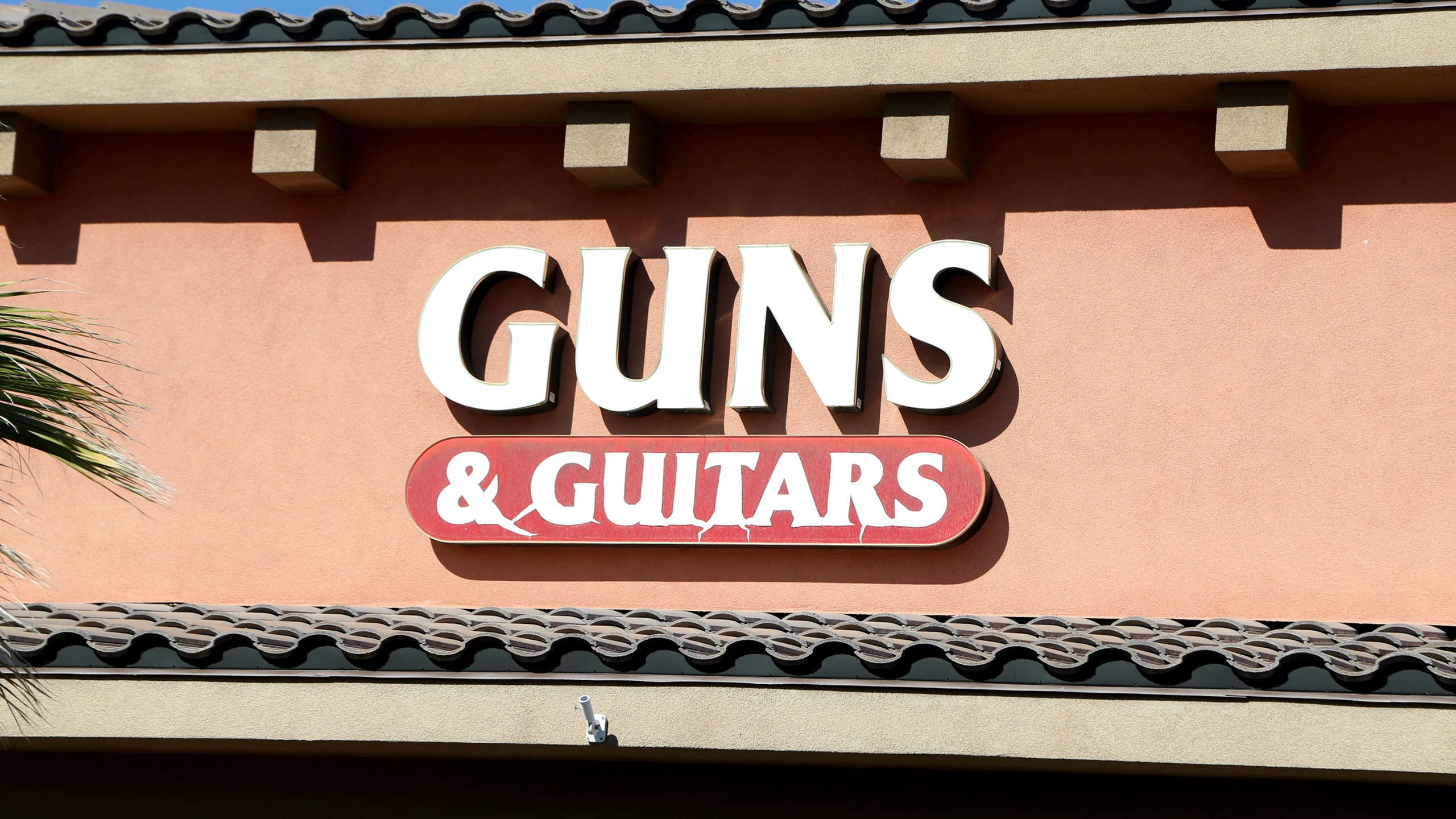 A sign for Guns & Guitars, a gun shop, where suspected Las Vegas gunman Stephen Paddock allegedly purchased firearms, October 2, 2017 in Mesquite, Nevada. (Credit: Gabe Ginsberg/Getty Images)