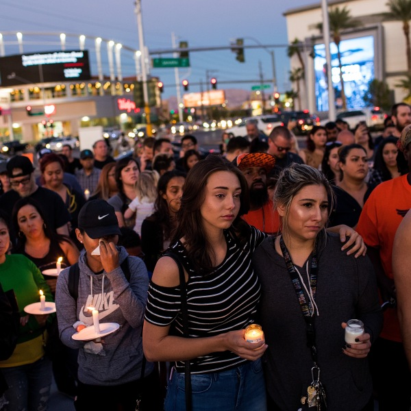 Mourners attend a candlelight vigil at the corner of Sahara Avenue and Las Vegas Boulevard for the victims of Sunday night's mass shooting, October 2, 2017 in Las Vegas, Nevada. (Credit: Drew Angerer/Getty Images)