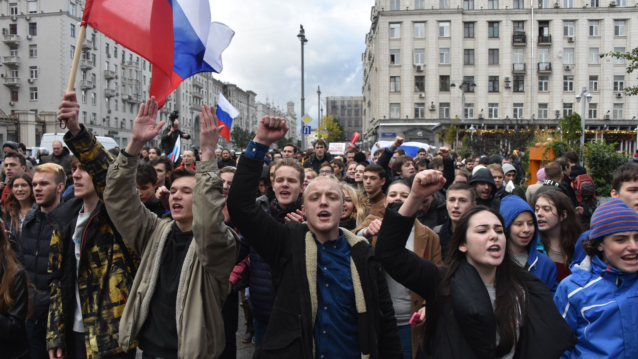 Demonstrators walk along Tverskaya Street during an unauthorized anti-Kremlin rally called by opposition leader Alexei Navalny, who is serving a 20-day jail sentence, in downtown Moscow on Oct. 7, 2017, President Vladimir Putin's 65th birthday. (Credit: Vasily Maximov / AFP / Getty Images)