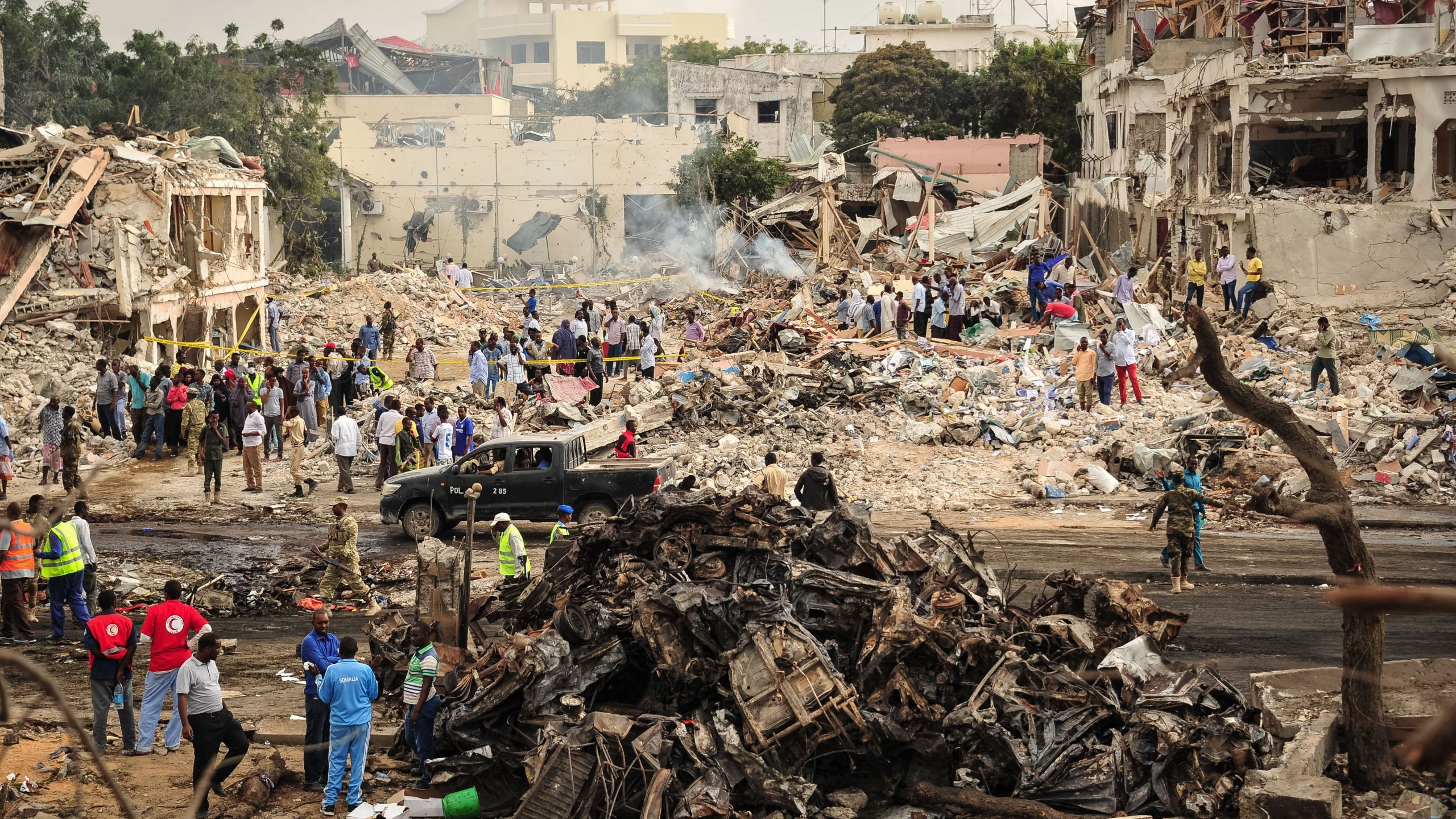 A picture taken on October 15, 2017 shows a general view of the scene of the explosion of a truck bomb in the centre of Mogadishu. (Credit: MOHAMED ABDIWAHAB/AFP/Getty Images)