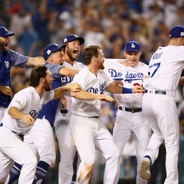 The Dodgers celebrate after Justin Turner hit the winning home run in the bottom of the ninth game two of the National League Championship Series against the Chicago Cubs at Dodger Stadium on October 15, 2017. (Credit: Ezra Shaw/Getty Images)