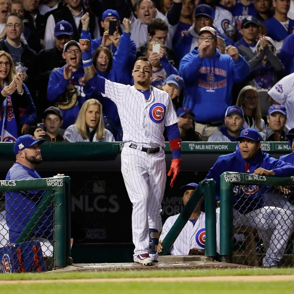 Javier Baez of the Chicago Cubs takes a curtain call after hitting a home run in the fifth inning against the Los Angeles Dodgers during game four of the National League Championship Series at Wrigley Field on October 18, 2017 in Chicago. (Credit: Jamie Squire/Getty Images)