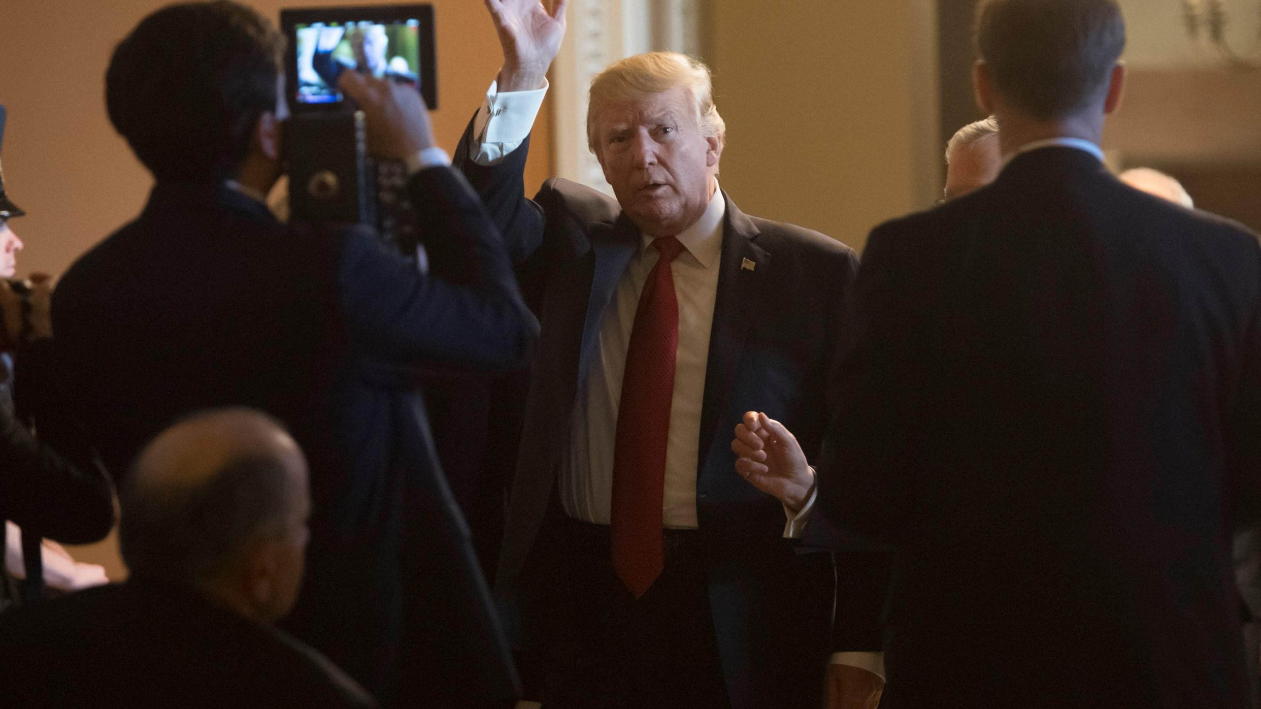 Donald Trump arrives to meet with Republican Senators at the U.S. Capitol on October 24, 2017. (Credit: Saul Loeb/AFP/Getty Images)