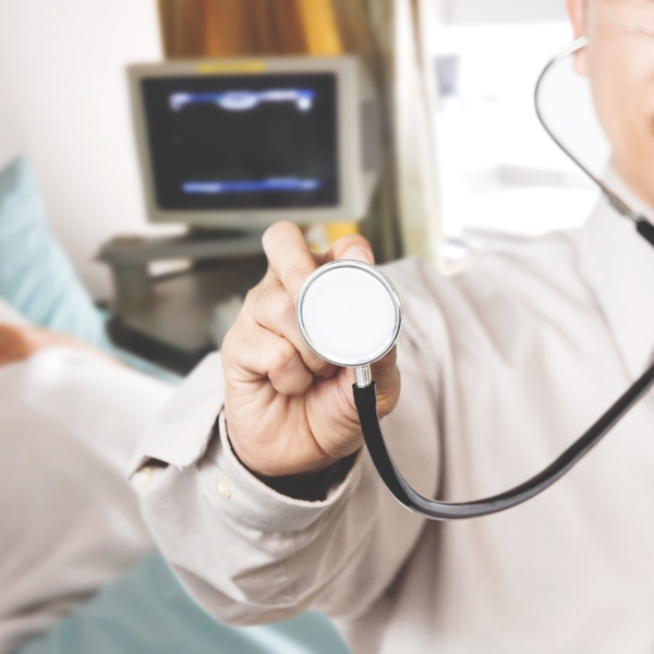A doctor with a stethoscope is seen in this file photo. (Credit: iStock / Getty Images Plus)
