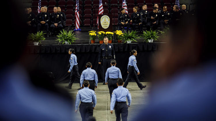 Cadets file past Police Chief Charlie Beck for inspection before their graduation ceremony at USC's Galen Center in June, 2017. (Credit: Marcus Yam / Los Angeles Times)