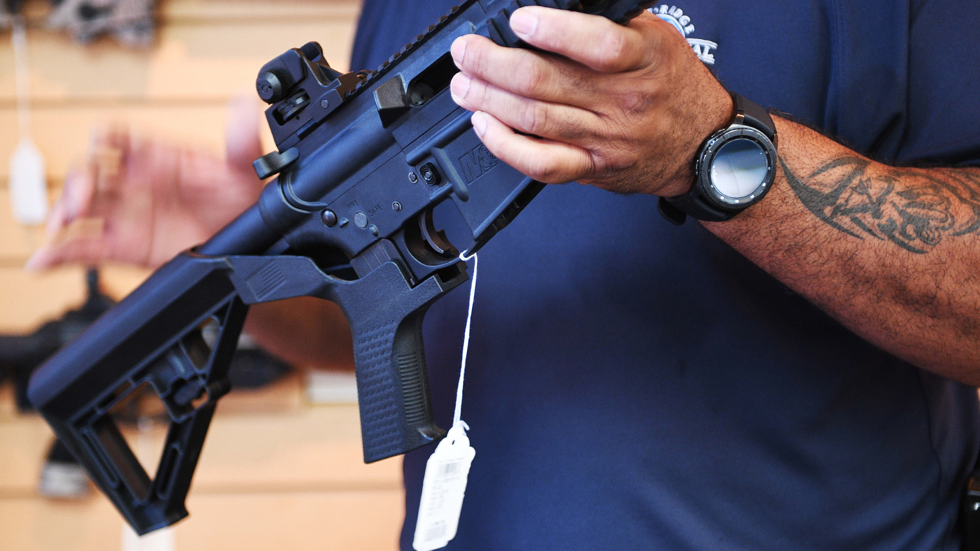 Gun salesman Mark Warner shows a bump stock installed on an AR-15 rifle at Blue Ridge Arsenal in Chantilly, Virgina, on Oct. 6, 2017. (Credit: Jim Watson/AFP/Getty Images)