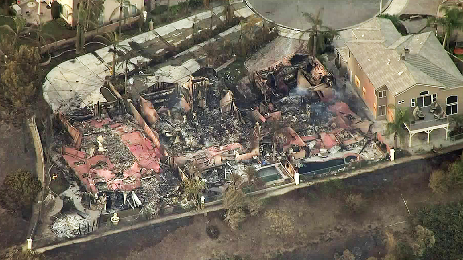 Three homes destroyed by Canyon Fire 2 are seen in Anaheim Hills on Oct. 10, 2017. (Credit: KTLA)